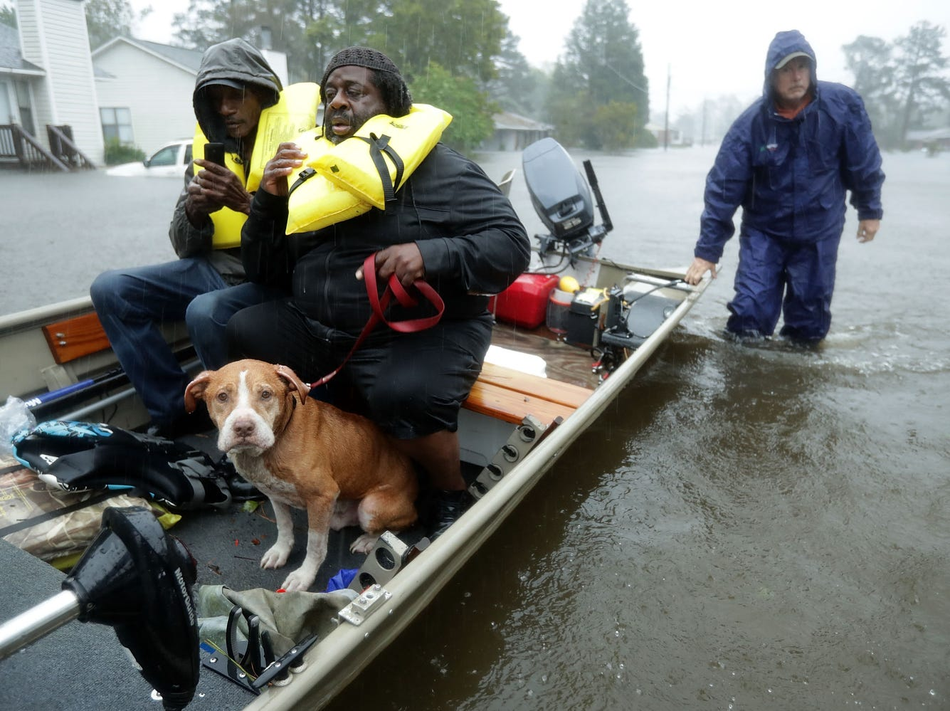 Volunteers from all over North Carolina help rescue residents and their pets from their flooded homes during  Florence Sept. 14, 2018 in New Bern, N.C. Hurricane Florence made landfall in North Carolina as a Category 1 storm and flooding from the heavy rain is forcing hundreds of people to call for emergency rescues in the area around New Bern, which sits at the confluence of the Nuese and Trent rivers.