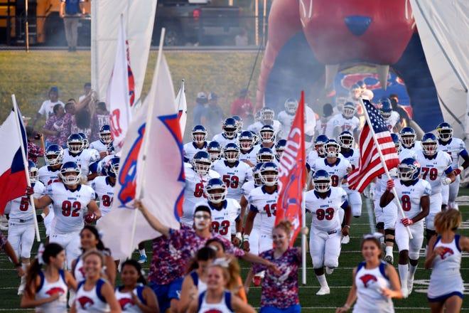 The Cooper High School Cougars take to the field for Friday's Crosstown Showdown  game against Abilene High Sept. 14, 2018. Abilene won, 20-13.