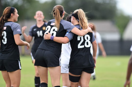 Hardin-Simmons midfielder Rachel Bean (26) hugs Kenne Kessler (28) after scoring the first goal during the Cowgirls' 3-1 win against Sul Ross State on Saturday, Sept. 15, 2018. It was the first night game with lights at the HSU Soccer Complex.