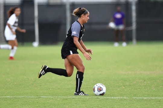 Hardin-Simmons forward Randie Dennison (10) takes possession during the Cowgirls' 3-1 win against Sul Ross State on Saturday, Sept. 15, 2018. It was the first night game with lights at the HSU Soccer Complex.