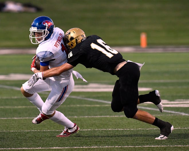 Abilene High defensive back Tyler Simpson pushes Cooper receiver Mason Reynolds to the sideline during the annual Crosstown Showdown game Sept. 14. at Shotwell Stadium. AHS won 20-13.