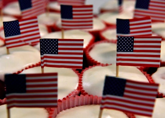 "Cupcakes with American flags sit in a tray during ""We Will Never Forget: A 9/11 Remembrance"", an event sponsored by the Eastland County Republican Party. Held at the River of Life Church youth center, the event featured Rafael Cruz, the father of Sen. Ted Cruz, as the keynote speaker."