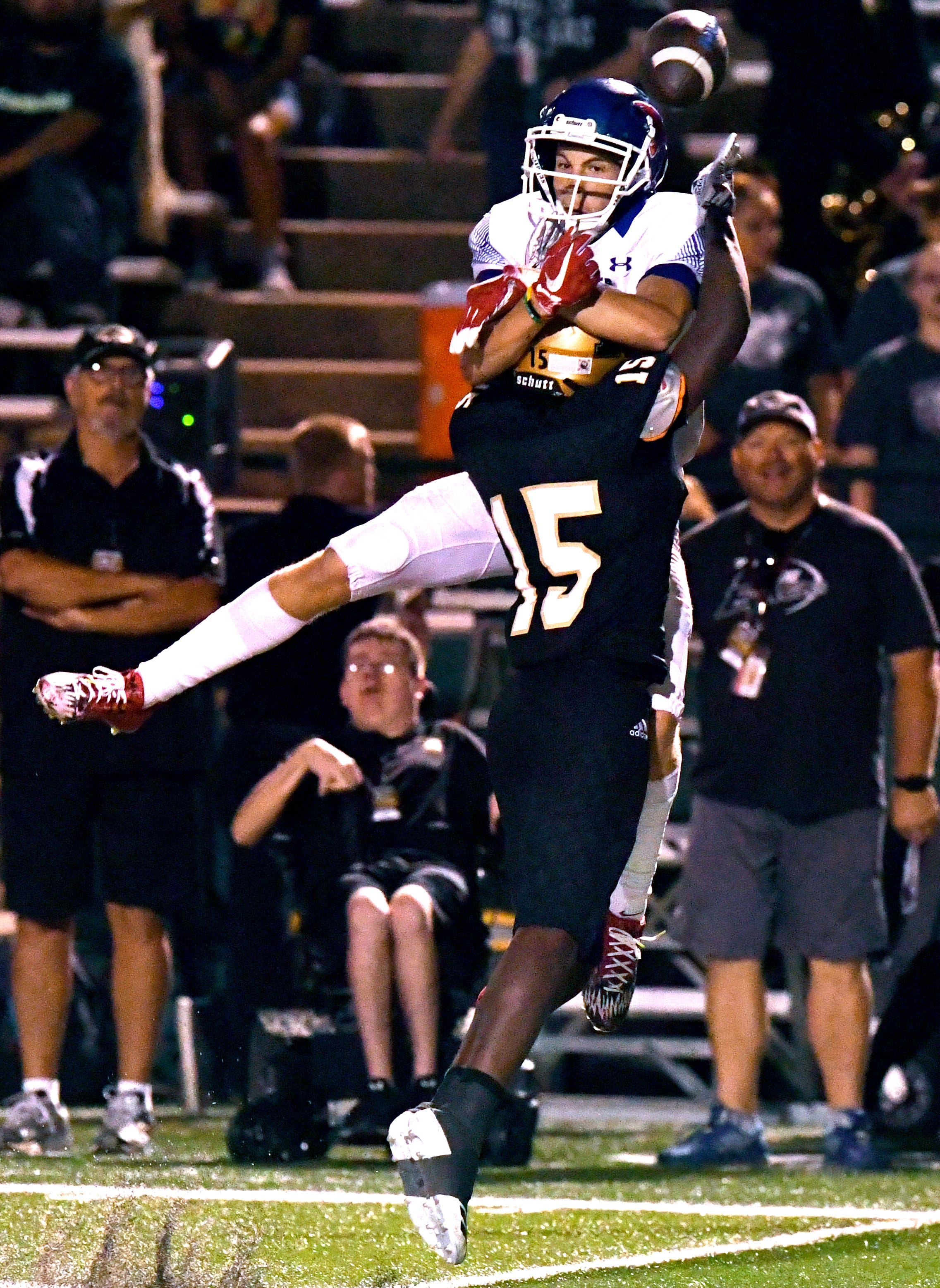 Abilene High defensive back Nathaniel Jones swats the ball away from Cooper wide receiver Mawson Reynolds, preventing the pass completion.