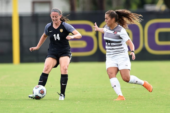 Hardin-Simmons midfielder Sarah Krisa (14) makes a pass during the Cowgirls' 3-1 win against Sul Ross State on Saturday, Sept. 15, 2018. It was the first night game with lights at the HSU Soccer Complex.