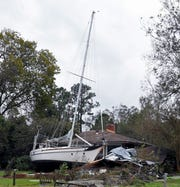 A large sailboat rests in a New Bern, North Carolina, backyard on Sunday, Sept. 16, 2018, after flooding from Hurricane Florence.
