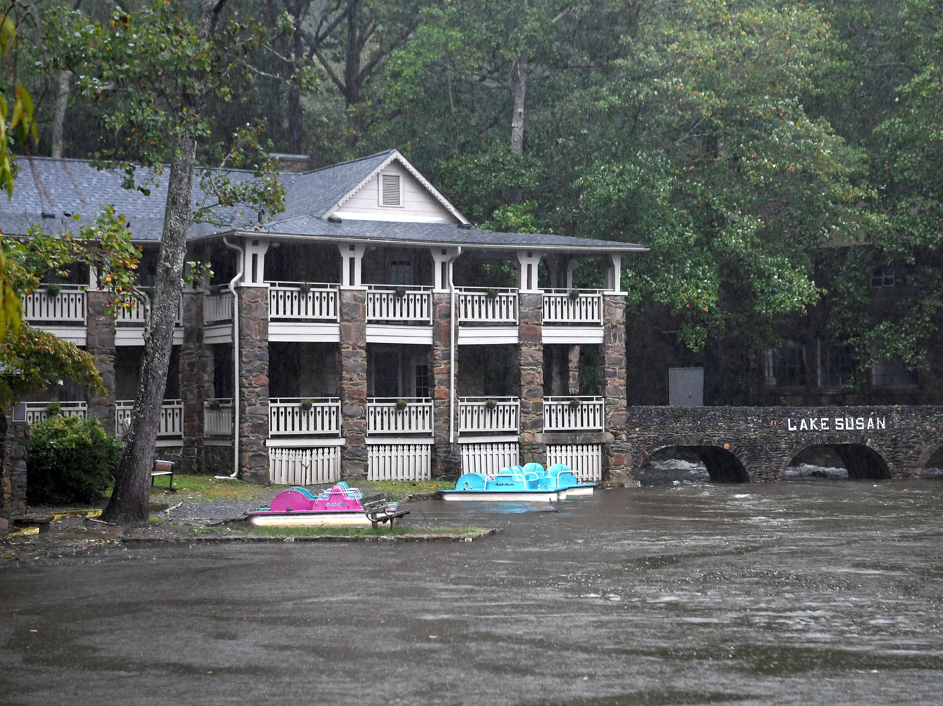 Lake Susan in Montreat rises close to the sidewalk as steady rain falls on Sept. 16, 2018.