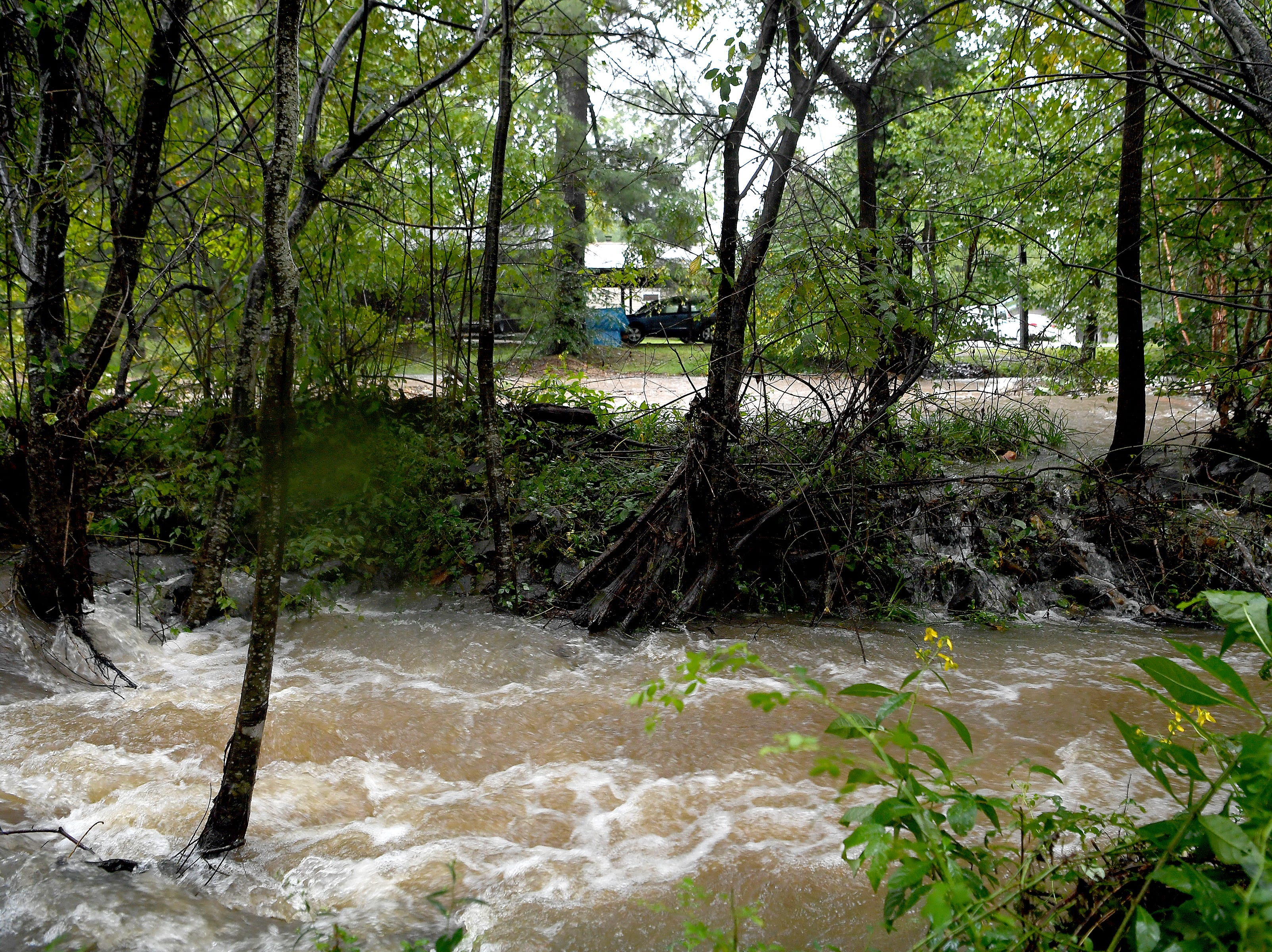 Water from Flat Creek flooded into the Portman Villas Mobile Home Park in Black Mountain and continued to rise forcing evacuations of homes on Sept. 16, 2018.
