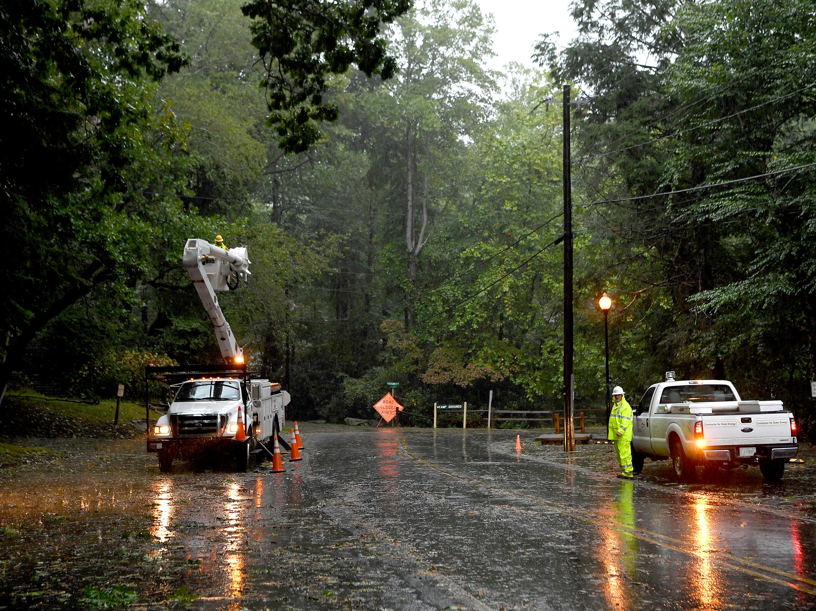 Electrical workers see to the lines in Montreat on Sept. 16, 2018.