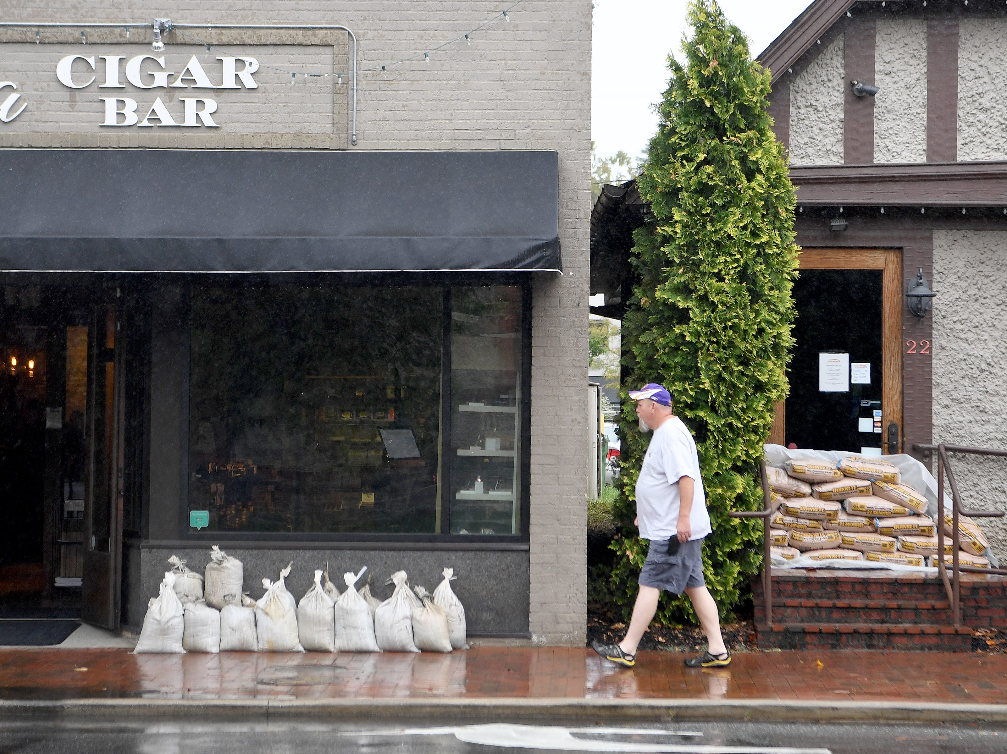 Business owners in Biltmore Village are prepared with sandbags in the event of flooding caused by Hurricane Florence, now downgraded to a tropical depression, on Sept. 16, 2018. Sunday was still business as usual in the area.