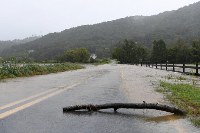 A stick was placed on Lower Brush Creek Road to monitor the rate of flooding as Cane Creek jumped its banks in September's Hurricane Florence. That was one of many storms helping to pad rainfall totals this year.
