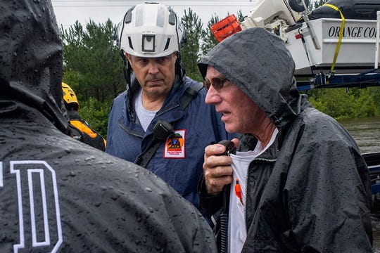 Beulaville Fire Chief Joey Carter, right, communicates with his men via radio while Craig Covey, chief of California Task Force Five, listens.