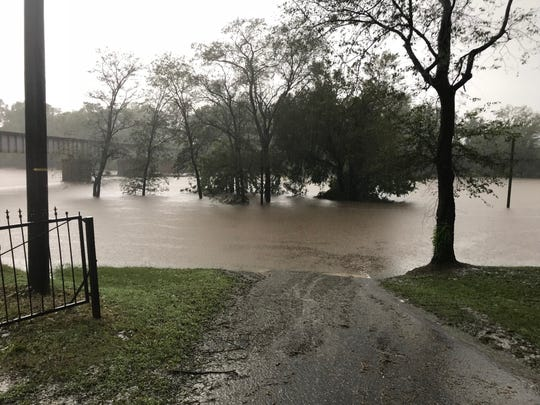 """The Cape Fear River had risen to 41 feet by 1 p.m. Sunday, covering a parking lot and trees on its east bank. The river is expected to cause """"catastrophic"""" flooding as it crests at 62 feet Tuesday."""