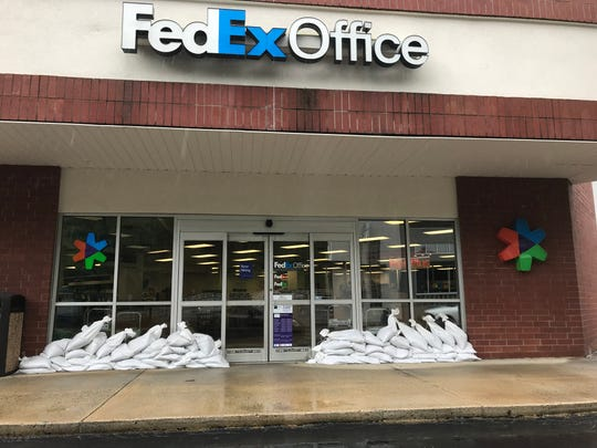 Many businesses in Biltmore Village had prepared for significant flooding from the remnants of Hurricane Florence.