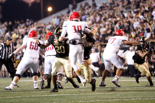 Western Michigan linebacker Najee Clayton sacks and forces a fumble by Delaware State quarterback Jack McDaniels at Waldo Stadium in Kalamazoo on September 15, 2018.