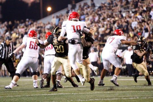 Western Michigan linebacker Najee Clayton sacks and forces a fumble by Delaware State quarterback Jack McDaniels at Waldo Stadium in Kalamazoo on September 15, 2018.