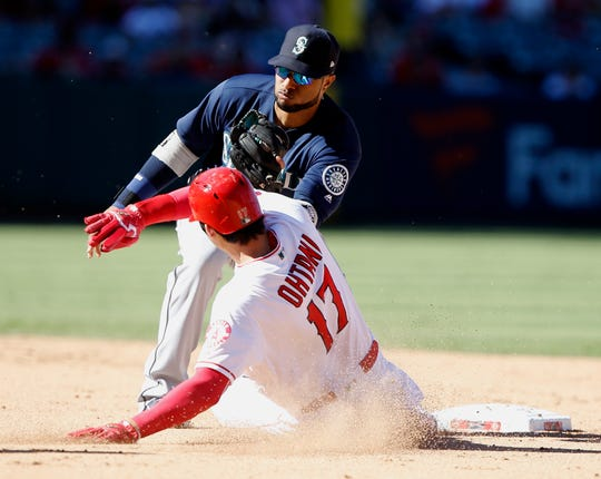 Seattle Mariners second baseman Robinson Cano takes the throw from catcher Mike Zunino in time to tag out the Angels' Shohei Ohtani trying to steal.