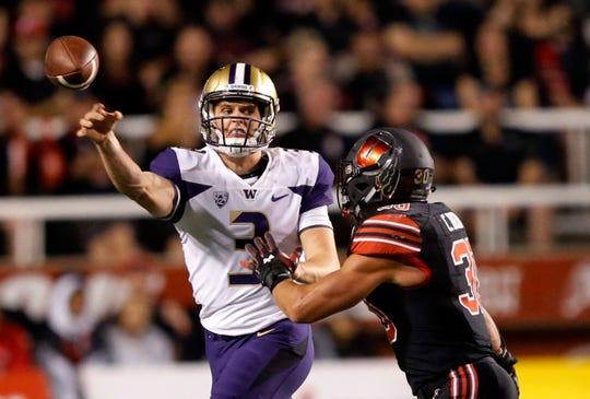 Washington quarterback Jake Browning (3) gets a pass away before being hit by Utah linebacker Cody Barton (30).