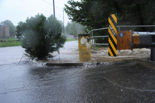 Water pours out of Flat Creek onto Charlotte Street, which began to fill with water around 6 p.m. on Sept. 16.
