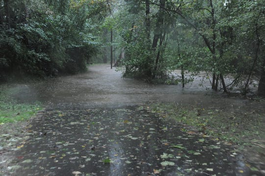 Flat Creek submerges a section of the greenway south of Portman Villas Mobile Home Park, from which five people were evacuated around 3:12 p.m.