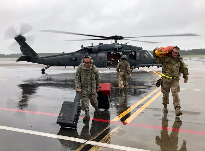 Air Force Staff Sgt. Joseph Velazquez (left) and Tech Sgt. Gary McGraw with the 920th Rescue Wing arrive Saturday night at Joint Base Charleston.