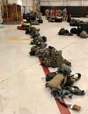 Gear owned by Patrick Air Force Base personnel lines the floor of a C-17 hangar at Joint Base Charleston.