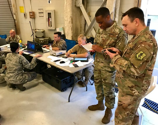 Logistics personnel check in airmen as they arrive for Florence rescue operations at Joint Base Charleston.