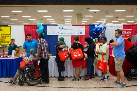People walk around and visit booths at the Best of the Best event on Sunday, Sept. 16, 2018 at the American Bank Center.