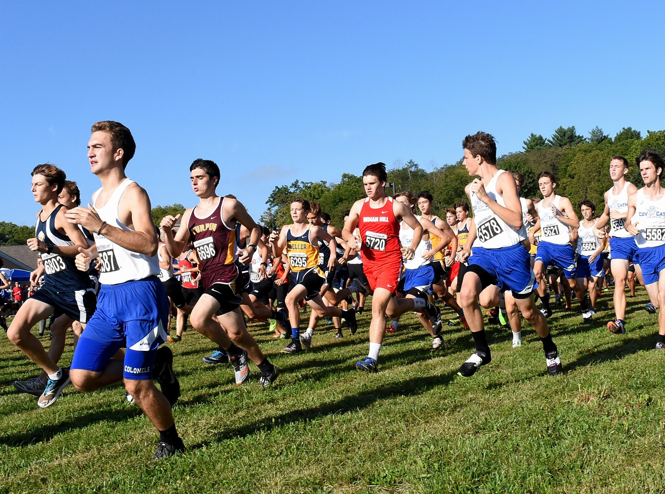 The fellas take the trail in the boys 5K Open at the 2018 Milford Cross Country Invitational, Sept. 15, 2018.