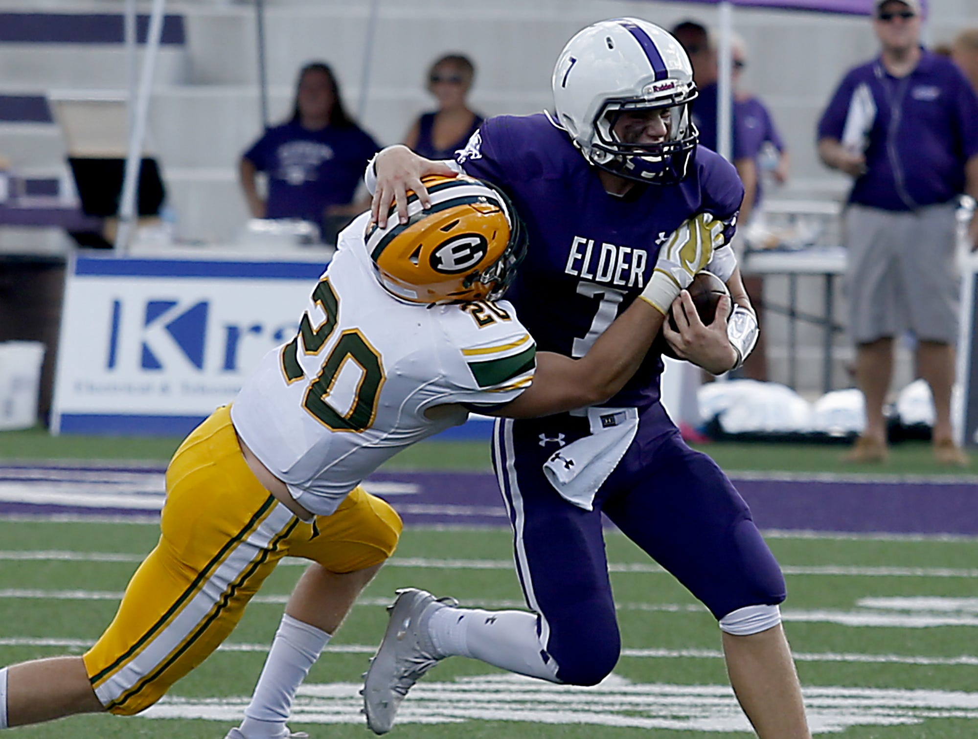 Elder quarterback Matthew Luebbe is caught by a St. Edward player during their game at The Pit in Cincinnati Saturday, Sept. 15, 2018.