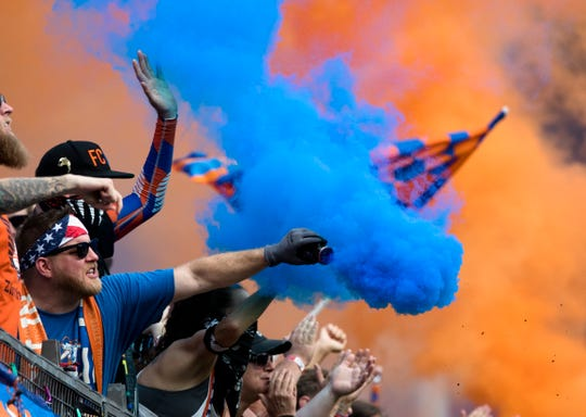 FC Cincinnati fans pop smoke bombs during the USL match between FC Cincinnati and Toronto FC on Sunday, Sept. 16, 2018, at Nippert Stadium in Cincinnati.