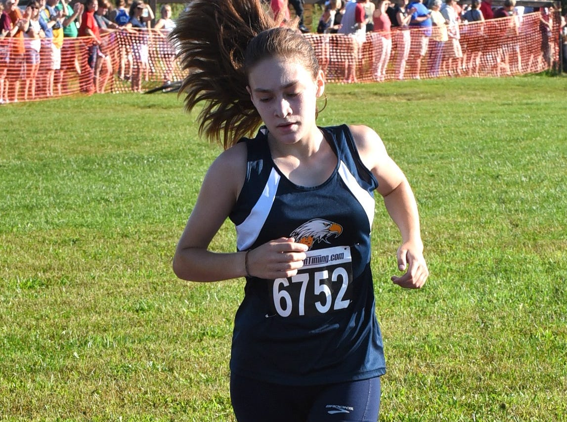 Charlotte Adams of Walnut Hills takes 2nd place in the Girls 5K Open at the 2018 Milford Cross Country Invitational, Sept. 15, 2018.