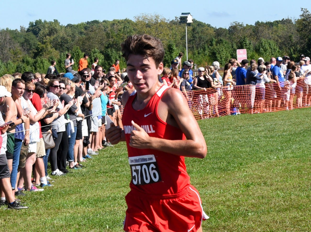 Ben Bayless of Indian Hill steps his way to a first-place finish in the varsity boys 5K race at the 2018 Milford Cross Country Invitational, Sept. 15, 2018.