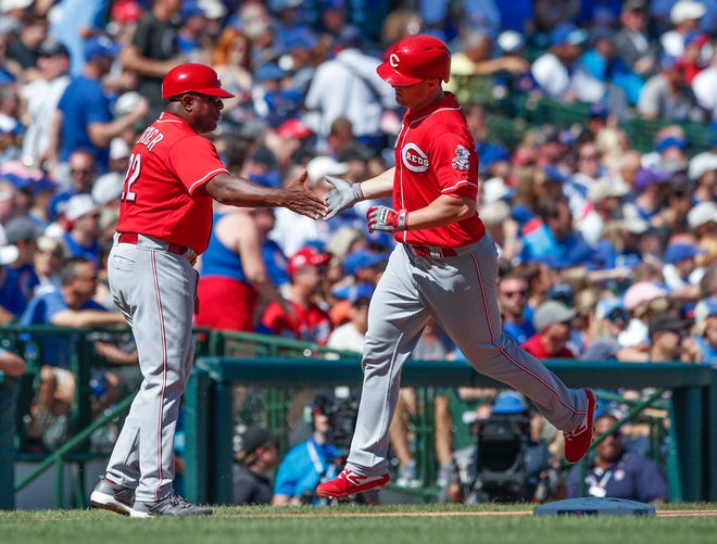Sep 15, 2018; Chicago, IL, USA; Cincinnati Reds right fielder Scott Schebler (43) celebrates with third base coach Billy Hatcher (22) after hitting a solo home run against the Chicago Cubs during the first inning at Wrigley Field. Mandatory Credit: Kamil Krzaczynski-USA TODAY Sports