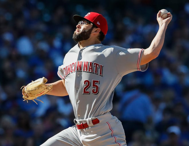 Sep 15, 2018; Chicago, IL, USA; Cincinnati Reds starting pitcher Cody Reed (25) delivers against the Chicago Cubs during the first inning at Wrigley Field. Mandatory Credit: Kamil Krzaczynski-USA TODAY Sports