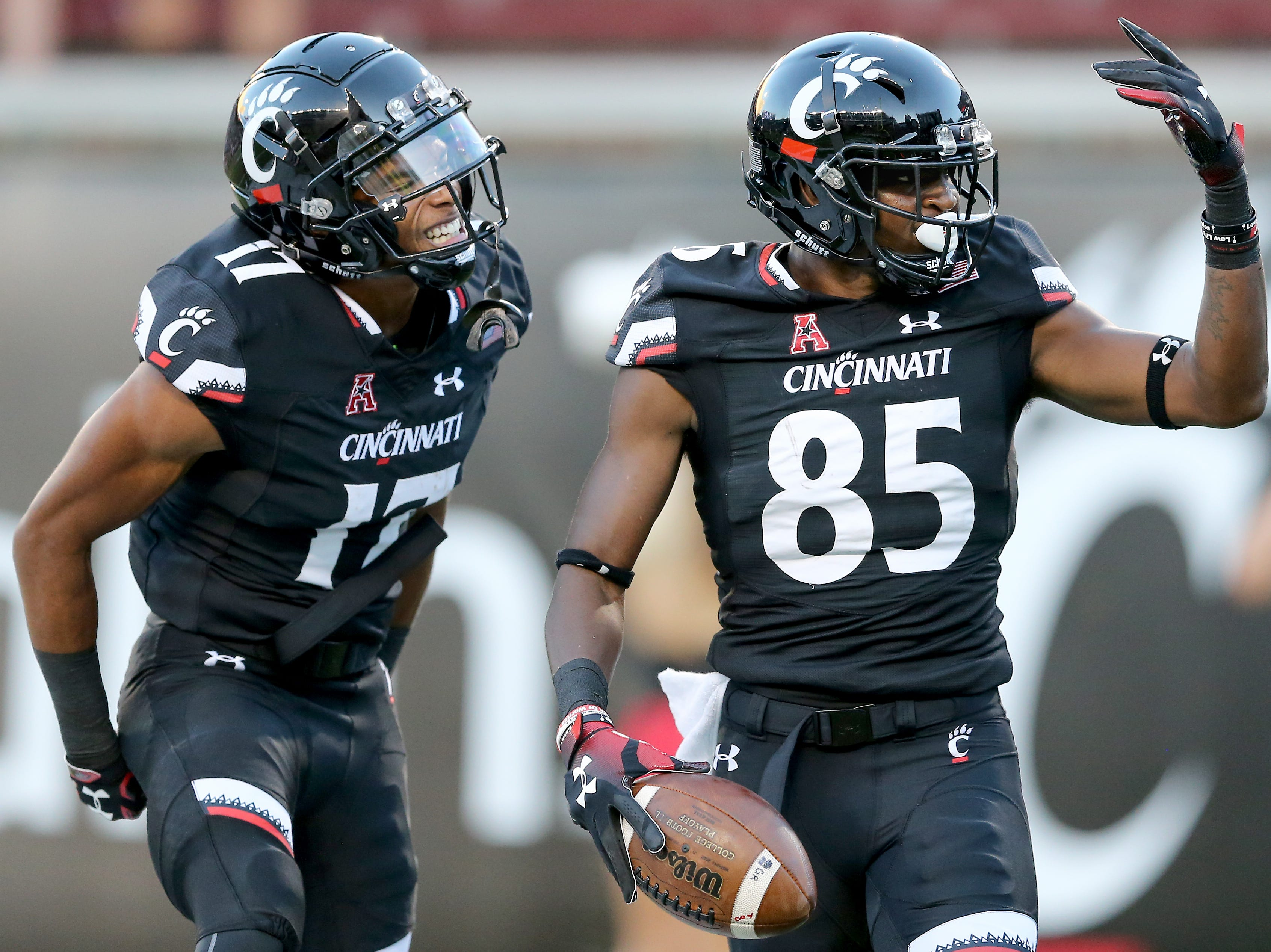 Cincinnati Bearcats wide receiver Thomas Geddis (85) celebrates a touchdown pass with Cincinnati Bearcats wide receiver Rashad Medaris (17) in the first quarter during a college football game between the Cincinnati Bearcats and the Alabama A&M Bulldogs, Saturday, Sept. 15, 2018, at Nippert Stadium in Cincinnati.