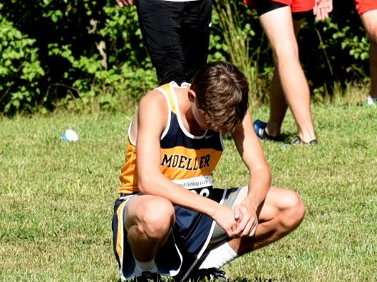 Moeller's Nicholas Eiben has a moment of quiet reflection before running in the boys varsity 5K race at the 2018 Milford Cross Country Invitational, Sept. 15, 2018.
