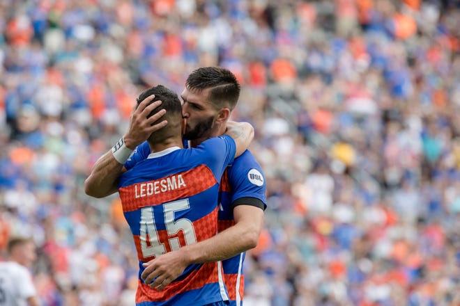 FC Cincinnati defender Forrest Lasso (3) kisses FC Cincinnati midfielder Emmanuel Ledesma (45) after scoring a goal off of Ledesma's assist during the USL match between FC Cincinnati and Toronto FC on Sunday, Sept. 16, 2018, at Nippert Stadium in Cincinnati.