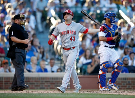 Sep 15, 2018; Chicago, IL, USA; Cincinnati Reds right fielder Scott Schebler (43) reacts after striking out against the Chicago Cubs during the eight inning at Wrigley Field. Mandatory Credit: Kamil Krzaczynski-USA TODAY Sports