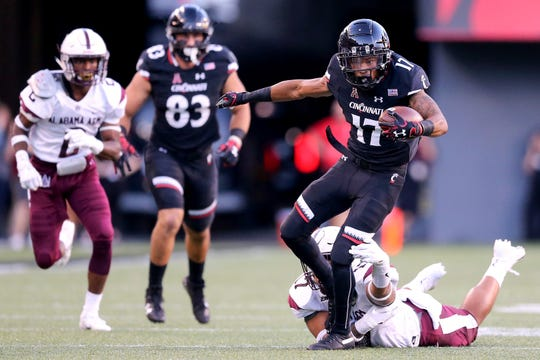 Cincinnati Bearcats wide receiver Rashad Medaris (17) completes a catch and run in the first quarter during a college football game between the Cincinnati Bearcats and the Alabama A&M Bulldogs, Saturday, Sept. 15, 2018, at Nippert Stadium in Cincinnati.