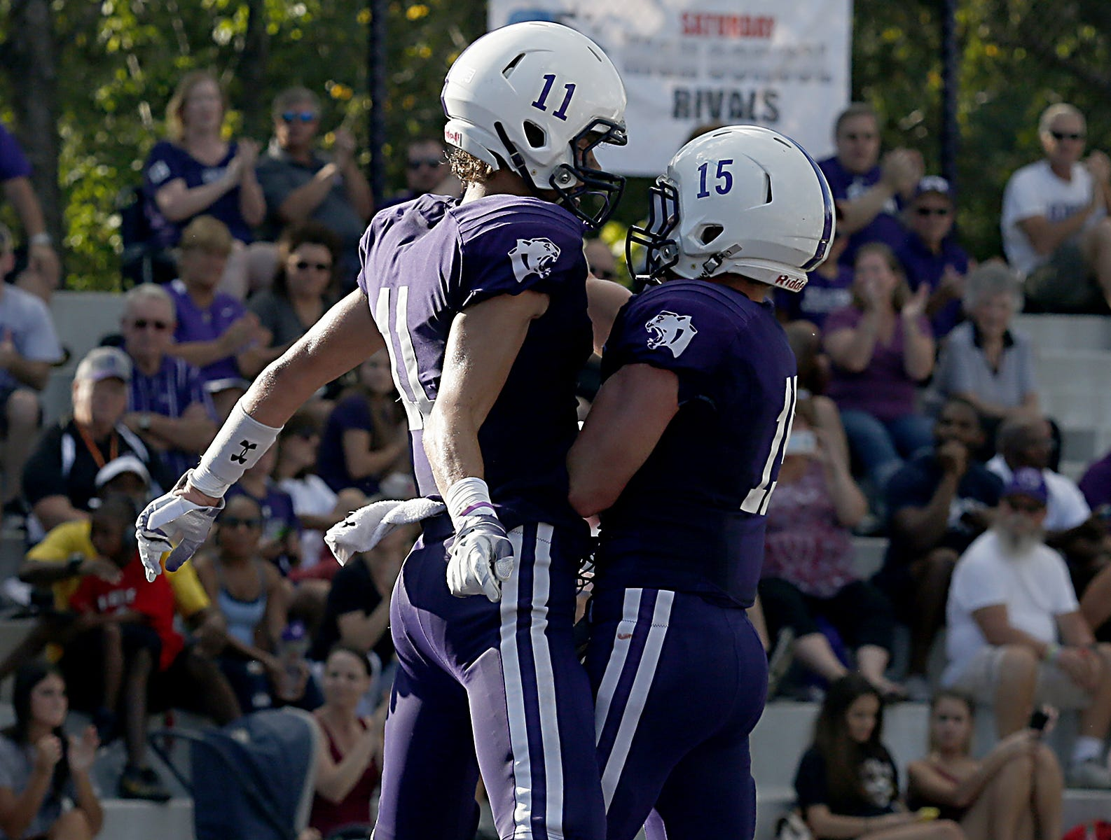 Elder's Joe Royer and Luke Masminster celebrate Roye's touchdown against St. Edward during their game at The Pit in Cincinnati Saturday, Sept. 15, 2018.