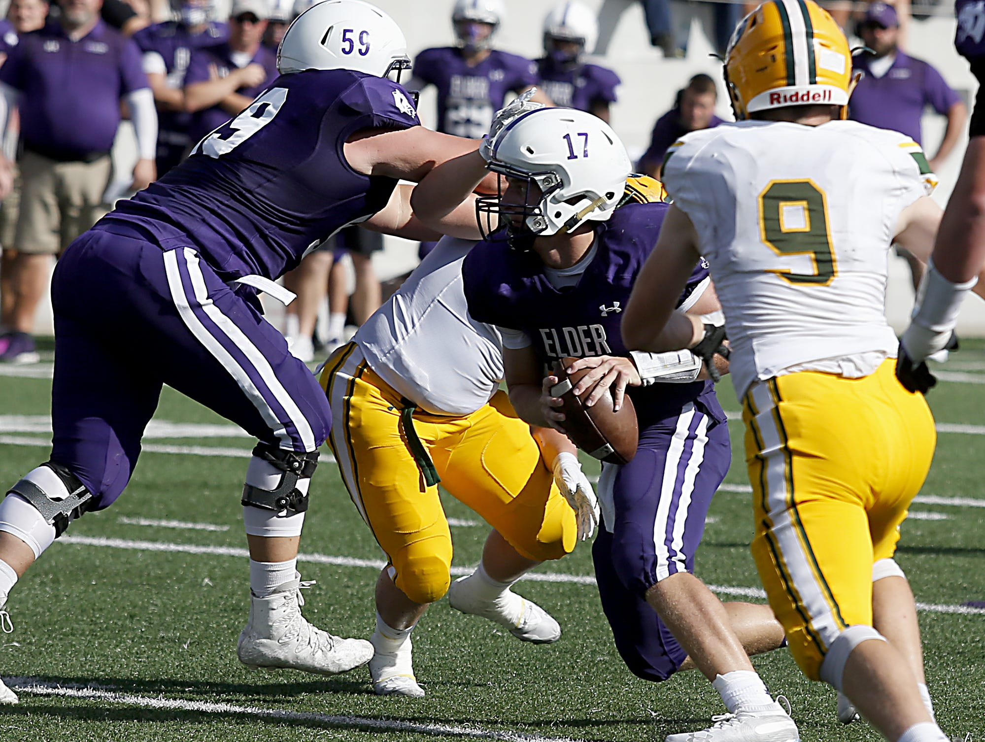 Elder quarterback Michael Bittner carries the ball against St. Edward during their game at The Pit in Cincinnati Saturday, Sept. 15, 2018.