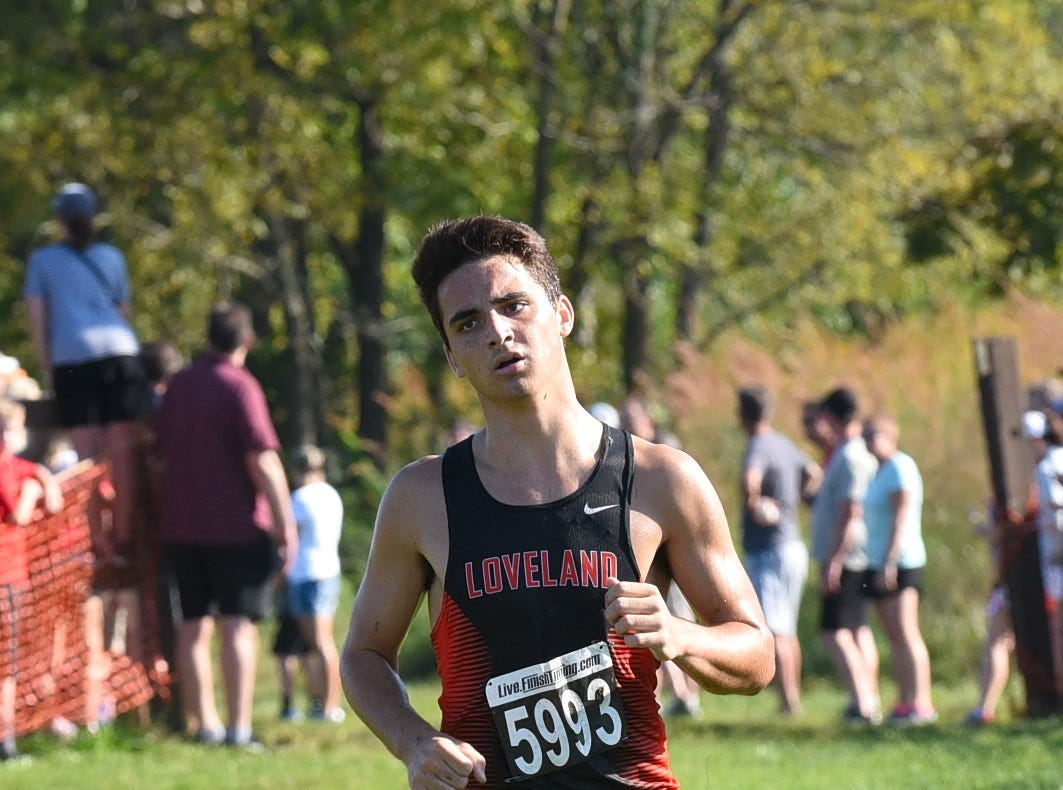 Ajay Stutz of Loveland heads to the end of the run for a 2nd Place finish in the Boys 5K Open run at the 2018 Milford Cross Country Invitational, Sept. 15, 2018.