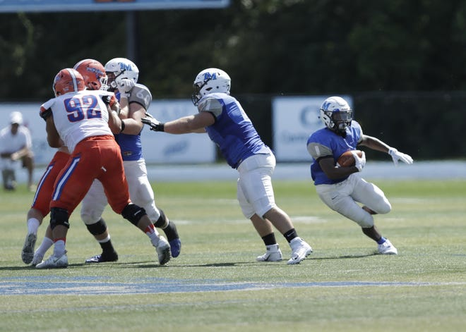 Thomas More College senior running back Hjavier Pitts find a big hole for one of his two touchdowns in the win over No. 16-ranked Wisconsin-Platteville, 35-28