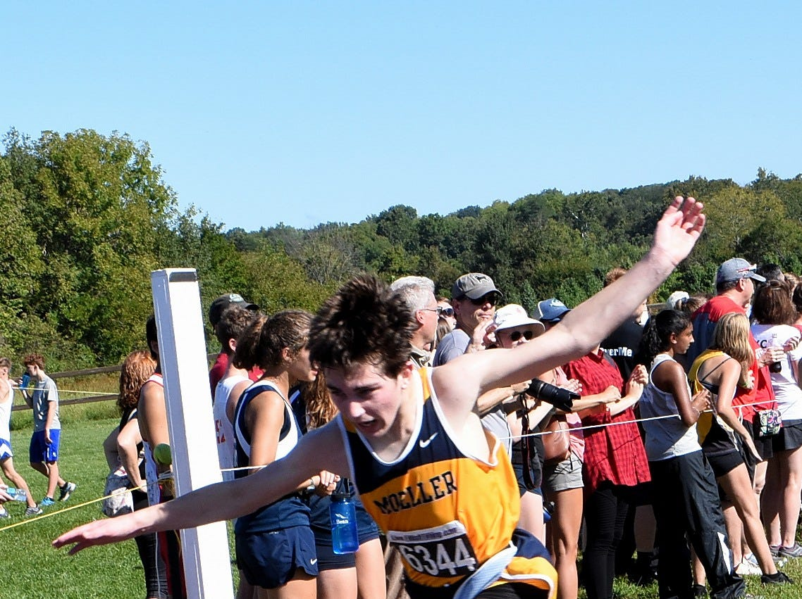 Brayden Zenni of Moeller powers through the finish line for the Crusaders while running at the 2018 Milford Cross Country Invitational, Sept. 15, 2018.