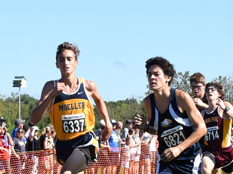 Moeller's Cannon Spelman and of Ryan Schrenk of Walnut Hills finish strong in the boys varsity 5K race at the 2018 Milford Cross Country Invitational, Sept. 15, 2018.