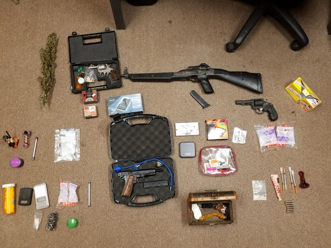 A traffic stop and search of Jeremy Warman and Laura Johnson's home resulted in the seizure of methamphetamine, heroin, prescription pills, marijuana, guns and drug paraphernalia.