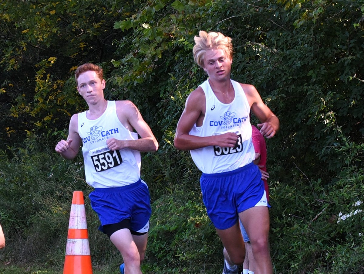 Ben Hail and Casey Wolnitzek of Covington Catholic run in stride in the boys varsity 5K race at the 2018 Milford Cross Country Invitational, Sept. 15, 2018.