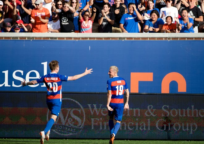 FC Cincinnati midfielder Corben Bone (19) celebrates after scoring a goal as FC Cincinnati midfielder Jimmy McLaughlin (20) runs towards him during the USL match between FC Cincinnati and Toronto FC on Sunday, Sept. 16, 2018, at Nippert Stadium in Cincinnati.