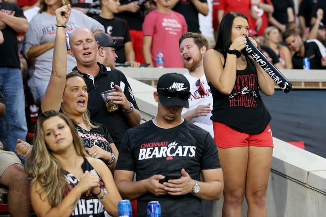 A Cincinnati Bearcats fan inflates a rumble stick in the first quarter during a college football game between the Cincinnati Bearcats and the Alabama A&M Bulldogs, Saturday, Sept. 15, 2018, at Nippert Stadium in Cincinnati.