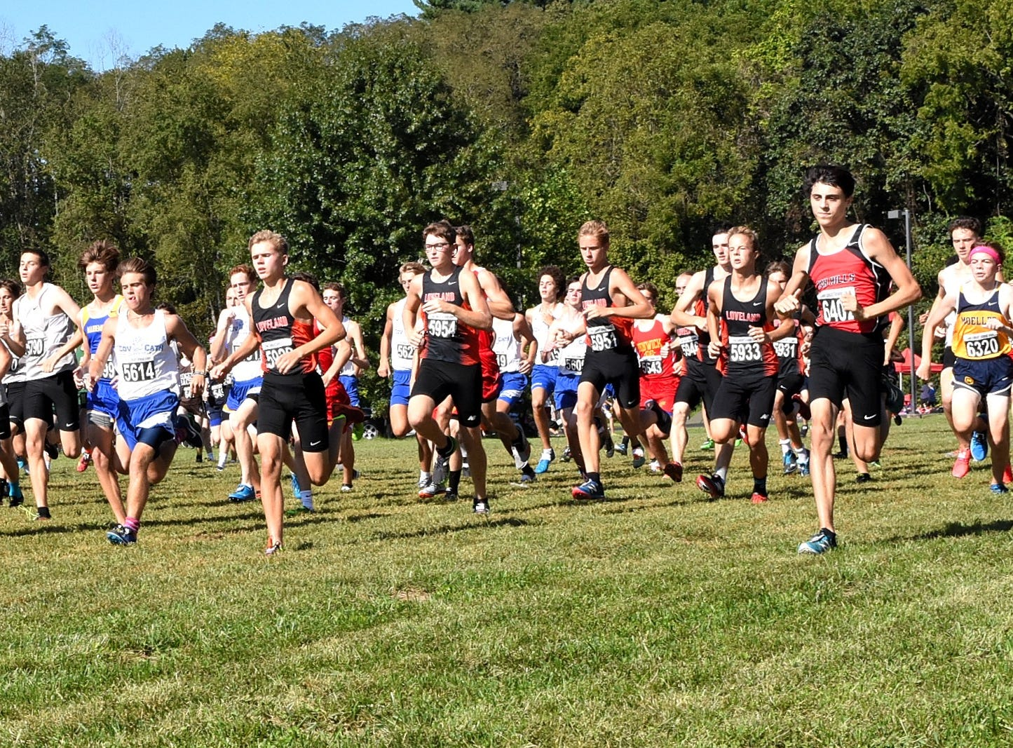 The guys are off and running in the boys varsity 5K race at the 2018 Milford Cross Country Invitational, Sept. 15, 2018.